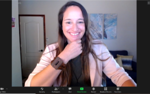 Woman Smiling in Zoom Meeting